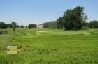 Odbočka u golfového hřiště